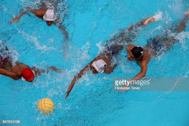 Ambani Vidya Mandir in white cap vs H R College Churchgate in blue cap playing water polo at ozone swimming centre at Goregaon