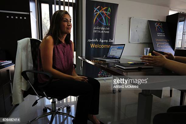 Ambar Amleh executive director of the Ibtikar investment fund speaks during an interview at her office in Ramallah on August 17 2016 It is one of a...