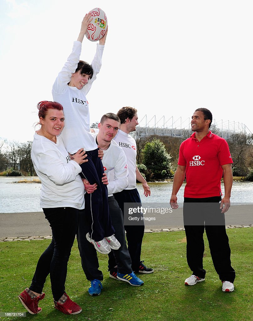 Ambassador and former dual-code rugby legend Jason Robinson (r) coaches young people from the Prince's Trust Fairbridge programme during a Rugby themed coaching session at Newcastle University on April 16, 2013 in Newcastle upon Tyne, England.