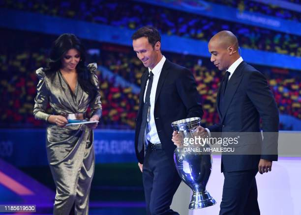 Ambassador and former football player of Portugal Ricardo Carvalho and Lokomotiv Moscow's Portuguese midfielder Joao Mario bring the trophy on stage...
