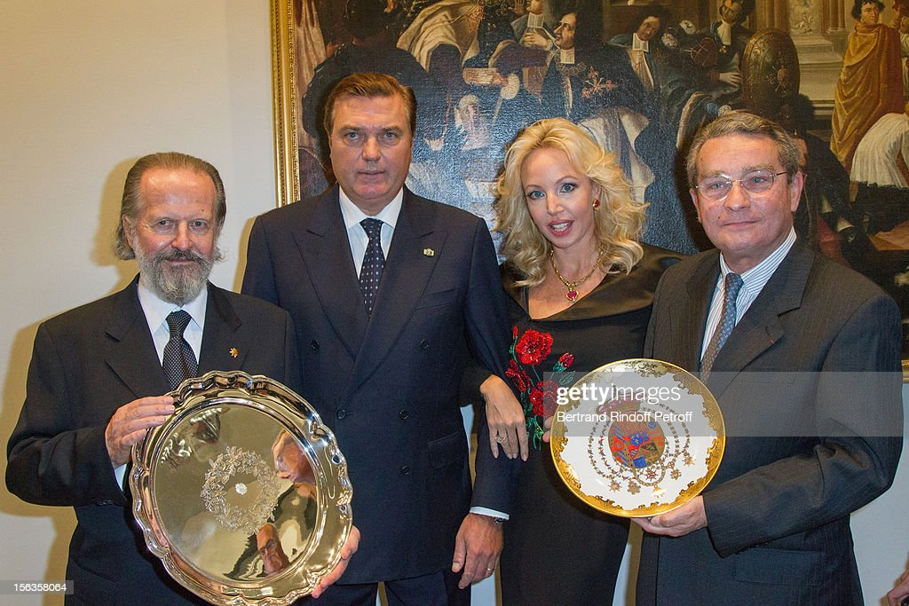 Ambassador Antonio Benedetto Spada (L) and Paris 8th district mayor Francois Lebel hold the presents they received, as Prince Charles of Bourbon-Two Sicilies and Princess Camilla of Bourbon-Two Sicilies look on, during the Royal House of Bourbon-Two Sicilies Exhibition on November 13, 2012 in Paris, France.