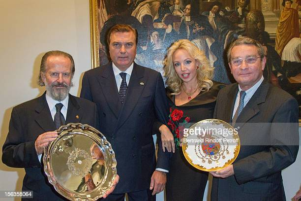 Ambassador Antonio Benedetto Spada and Paris 8th district mayor Francois Lebel hold the presents they received as Prince Charles of BourbonTwo...