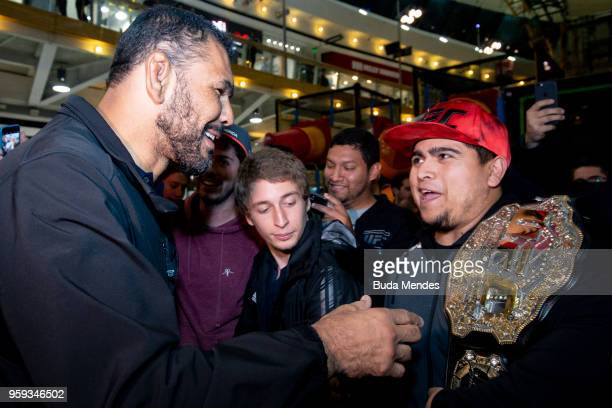 UFC ambassador Antonio Rodrigo 'Minotauro' Nogueira interacts with fans during an open training session at Mall Sport on May 16 2018 in Santiago Chile