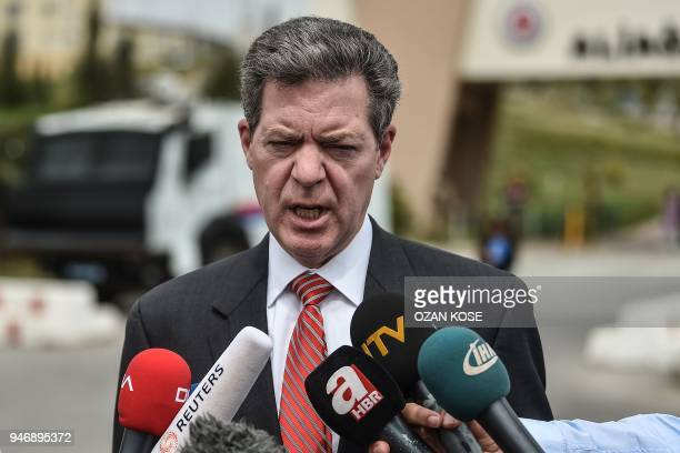 US ambassador at large for religious freedoms Samual Brownback speaks to journalists in front of the Aliaga court and prison complex during the trial...