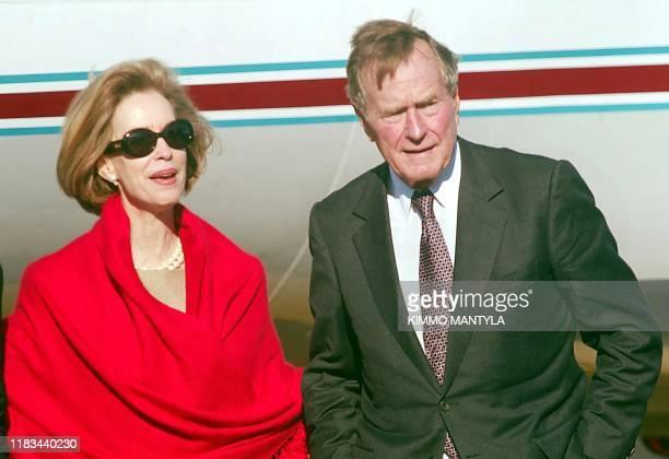 US Ambassador Bonnie McElveenHunter welcomes former US president George Bush at HelsinkiVantaa airport 29 September 2002 Bush is in Finland on a...