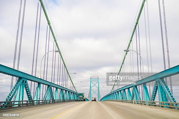 ambassador bridge between canada and the united states - detroit river stock photos and pictures