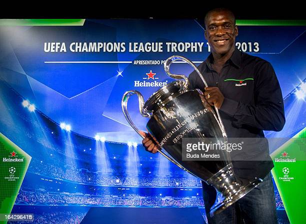Ambassador Clarence Seedorf poses with the UEFA Champions League trophy during the UEFA Champions League Trophy Tour 2013 at Casa Miranda on March...
