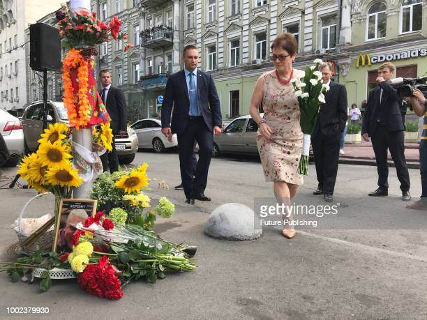 Ambassador Extraordinary and Plenipotentiary of the United States to Ukraine Marie Yovanovitch lays flowers at the portrait of perished journalist...