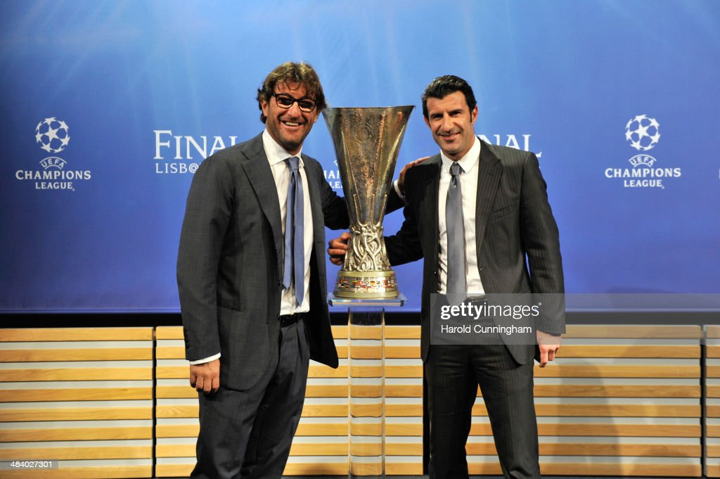 Ambassador for the Europa League final Ciro Ferrara (L) and Ambassador for the Champions League final Luis Figo (R) pose with Europa League trophy during the UEFA Europa League 2013/14 season semi-finals draw at the UEFA headquarters, The House of European Football, on April 11, 2014 in Nyon, Switzerland.