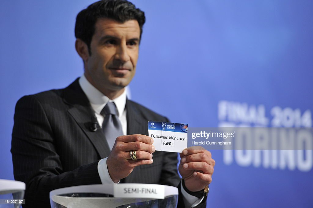 Ambassador for the final Luis Figo draws Bayern Munich during the UEFA Champions League 2013/14 season semi-finals draw at the UEFA headquarters, The House of European Football, on April 11, 2014 in Nyon, Switzerland.