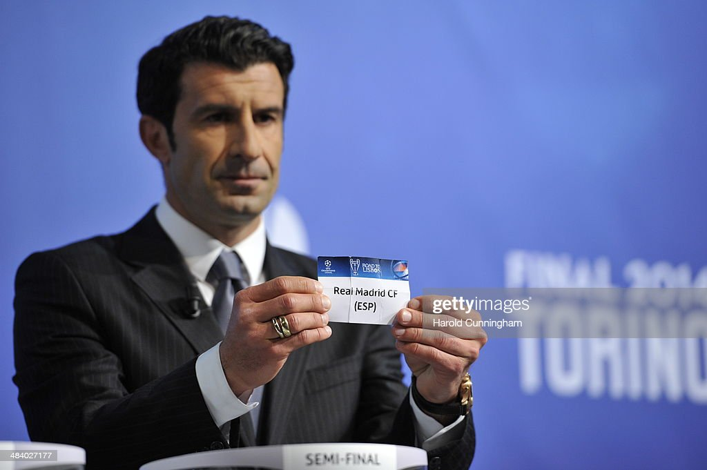 Ambassador for the final Luis Figo draws Real Madrid during the UEFA Champions League 2013/14 season semi-finals draw at the UEFA headquarters, The House of European Football, on April 11, 2014 in Nyon, Switzerland.