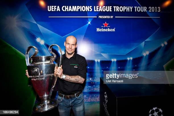 Ambassador Fredrik Ljungberg poses with the UEFA Champions League trophy during the UEFA Champions League Trophy Tour 2013 presented by Heineken at...