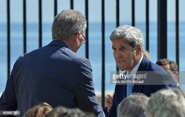 US Ambassador in Havana Jeffrey DeLaurentis shakes hands with US Secretary of State John Kerry during the US Embassy building reopening ceremony in...