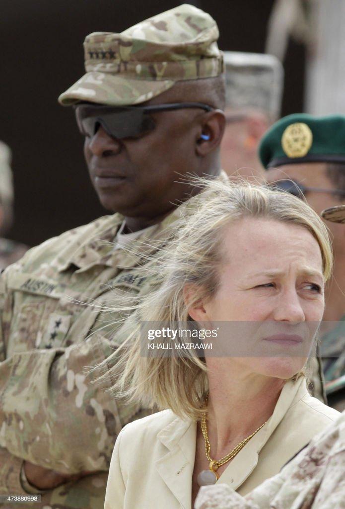 US ambassador in Jordan Alice Wells watches the