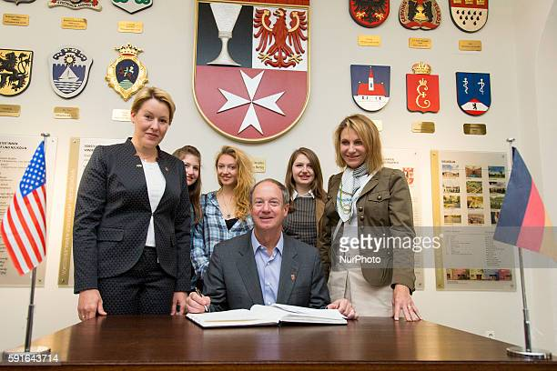 US ambassador John B Emerson his wife Kimberly Marteau Emerson their daughters Jacqueline Taylor and Hayley Emerson pose for a picture with Mayor of...