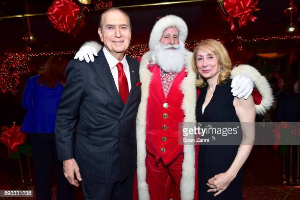 Ambassador John Loeb Santa Claus and Sharon Loeb attend A Christmas Cheer Holiday Party 2017 Hosted by George Farias and Anne and Jay McInerney at...