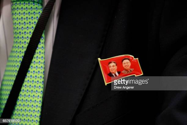 Ambassador Kim In Ryong Deputy Permanent Representative to the United Nations for the Democratic People's Republic of Korea wears a lapel pin...