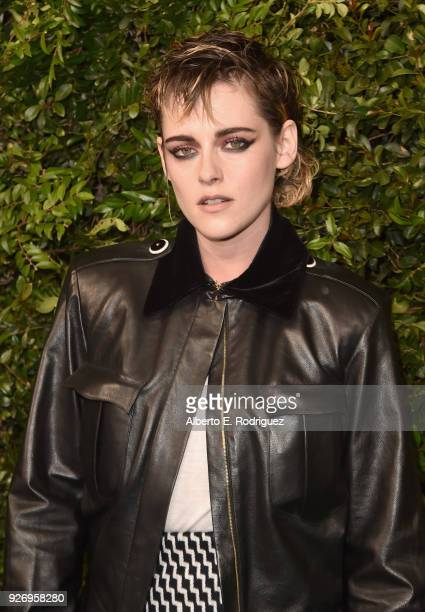 Ambassador Kristen Stewart wearing CHANEL attends Charles Finch and Chanel PreOscar Awards Dinner at Madeo in Beverly Hills on March 3 2018 in...