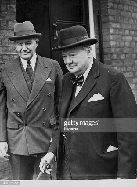US Ambassador Lewis Douglas and Leader of the Opposition Sir Winston Churchill arriving together at the House of Commons to discuss the devaluation...