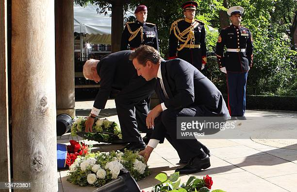 US Ambassador Louis Susman and British Prime Minister David Cameron lay wreathes as they attend the tenth anniversary ceremony of victims of the...