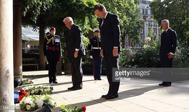 US Ambassador Louis Susman British Prime Minister David Cameron and Prince Charles Prince of Wales attend the tenth anniversary ceremony of victims...