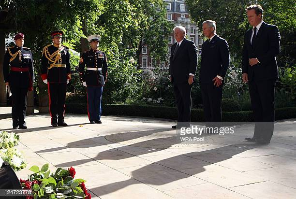 US Ambassador Louis Susman Prince Charles Prince of Wales and British Prime Minister David Cameron attend the tenth anniversary ceremony of victims...
