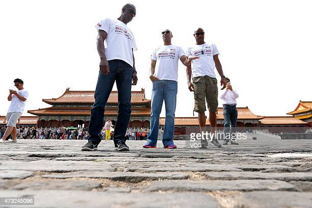IAAF Ambassador Michael Johnson of the United States athlete Colin Ray Jackson of England and Mike Powell of USA visit the Imperial Palace the 100...