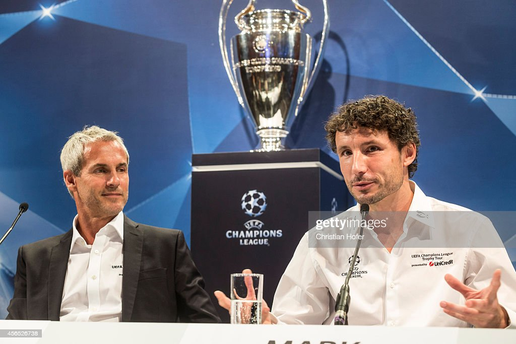 Ambassador Michael Konsel (L) and UEFA Ambassador Mark van Bommel attend the press conference prior to the Unicredit UEFA Champions League Trophy Tour on October 2, 2014 in Vienna, Austria.