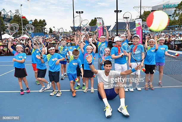 ANZ ambassador Novak Djokovic of Serbia poses with ANZ Tennis Hot Shots participants from Melbourne and Shanghai during day two of the 2016...