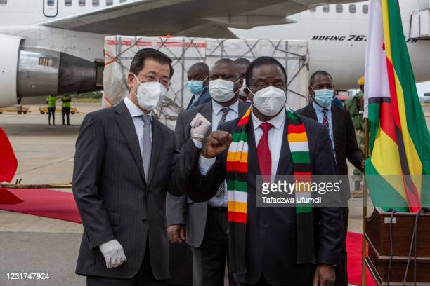 Ambassador of China to Zimbabwe and president Emmerson Mnangagwa shacks hands at the arrival of the 2nd shipment of Sinovac and Sinopharm vaccines...