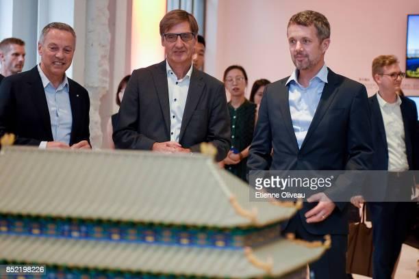 Ambassador of Danmark A Carsten Damsgaard Chairman of Danish Culture Institute Carsten Haurum and The Crown Prince Frederik of Denmark look at a big...