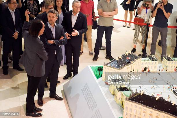 Ambassador of Danmark A Carsten Damsgaard Director of DCC Eric Messersmidt and The Crown Prince Frederik of Denmark discuss standing in front of a...