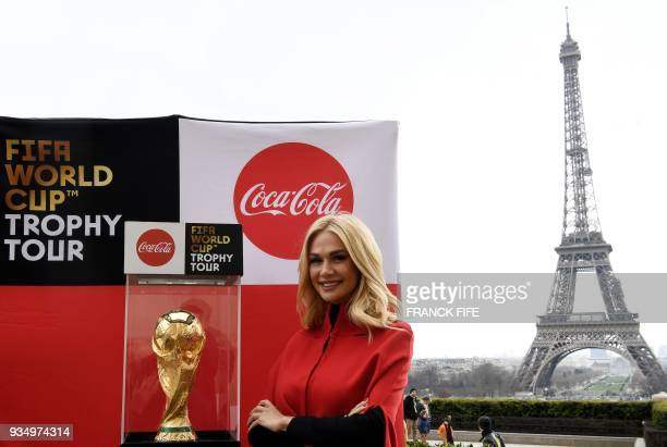 Ambassador of FIFA Russia World Cup 2018 model Victoria Lopyreva poses by the FIFA World Cup trophy with the Eiffel tower in background during the...