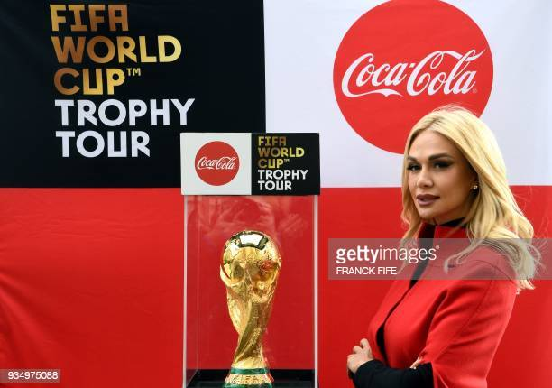 Ambassador of FIFA Russia World Cup 2018 model Victoria Lopyreva poses by the FIFA World Cup trophy during the FIFA World Cup Trophy Tour on March 20...