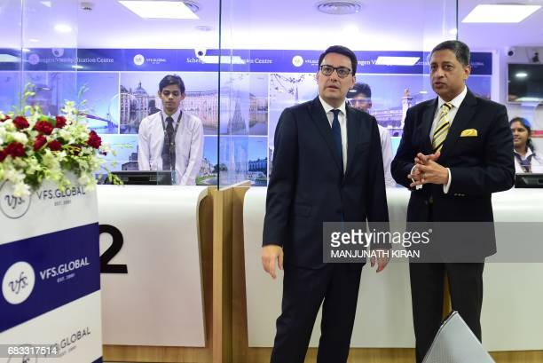 Ambassador of France to India Alexandre Ziegler and Chief Operating Officer of VFS Global Vinay Malhotra look on after opening the French Visa...