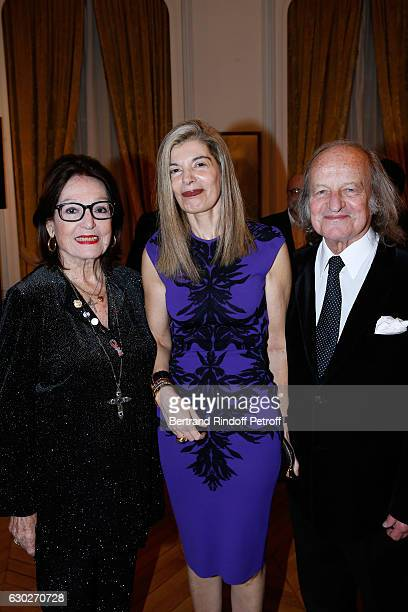 Ambassador of Greece in Paris Maria Theofili standing between Singer Nana Mouskouri and her husband Andre Chapelle attend Nana Mouskouri gives the...
