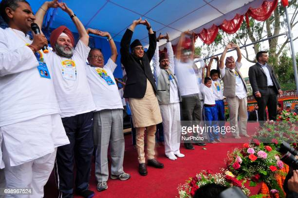 Ambassador of India to Nepal Manjeev Singh Puri Prime Minister of Nepal Sher Bahadur Deuba along with VIPs performing Yoga Position during the...