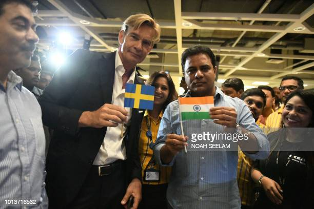 Ambassador of Sweden Mr Klas Molin with K Taraka Rama Rao State Minister of Telangana holds flags of India and Sweden during the opening ceremony of...