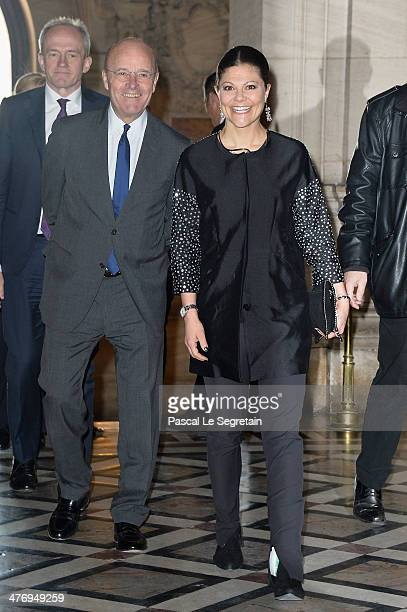 Ambassador of Sweden to France Gunnar Lund and Crown Princess Victoria of Sweden arrive at the Opera Garnier on March 6 2014 in Paris France