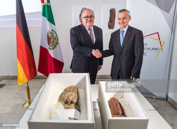 Ambassador of the Mexican Government Rogelio Granguillhome shakes hands with the director of the of the Archaeological State Collection in Munich...
