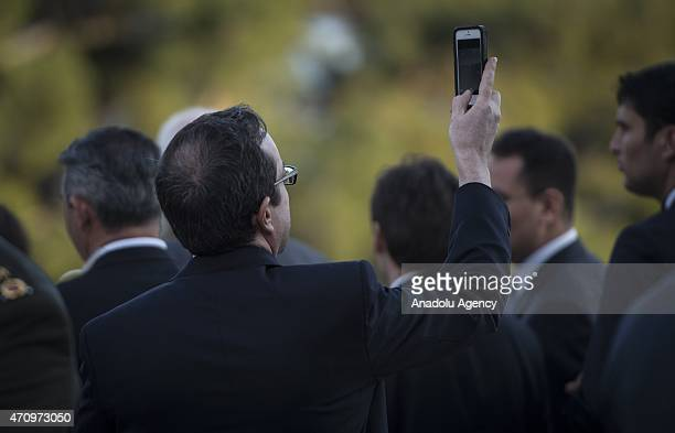 Ambassador of the United States to Turkey John Bass takes a picture as he attends the commemoration ceremony marking the 100th anniversary of the...