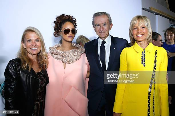 Ambassador of USA in France, Jane D. Hartley, Singer Rihanna, Owner of LVMH Luxury Group Bernard Arnault and his wife Helene Arnault pose Backstage...