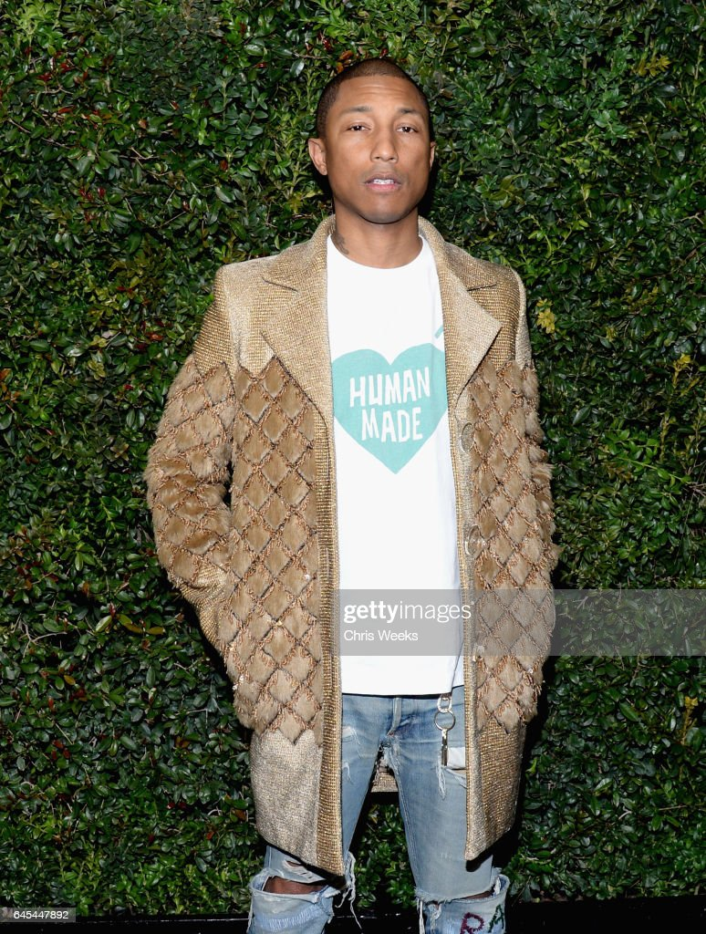 Ambassador Pharrell Williams, wearing CHANEL, attends the Charles Finch and CHANEL Pre-Oscar Awards Dinner at Madeo Restaurant on February 25, 2017 in Beverly Hills, California.