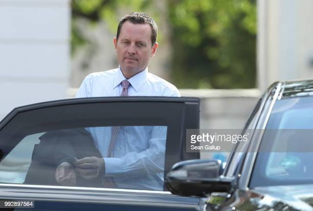 S Ambassador Richard Grenell departs after attending a reception for the internaitonal diplomatic corps hosted by German Chancellor Angela Merkel at...