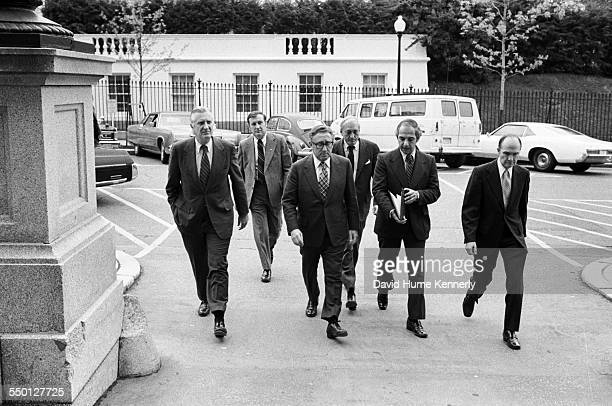 Ambassador Robert Anderson Secret Service Agent Secretary of State Henry Kissinger unidentified staff Press Secretary Ron Nessen and Deputy NSC...