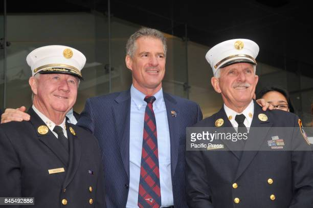 Ambassador Scott Brown and former New York Firefighter Chief Steven San Filippo after the commemoration Firefighters from across the country climbs...