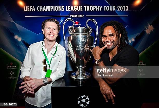 Ambassador Steve McManaman and Christian Karembeu poses with the UEFA Champions League trophy during the UEFA Champions League Trophy Tour 2013...