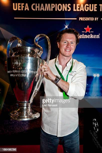 Ambassador Steve McManaman poses with the UEFA Champions League trophy during the UEFA Champions League Trophy Tour 2013 presented by Heineken at...