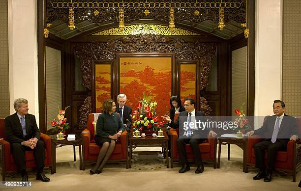 US Ambassador to China Max Baucus US House Minority Leader Nancy Pelosi of California and Chinese Foreign Minister Wang Yi listen as Chinese Premier...