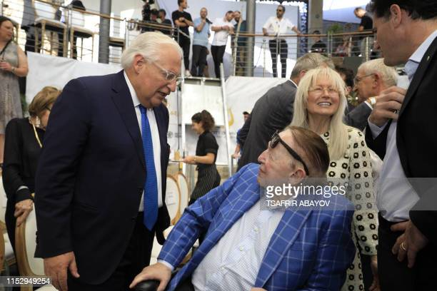 US Ambassador to David Friedman speaks with US businessman and philanthropist Sheldon Adelson and his wife Miriam during the opening of an ancient...
